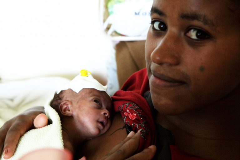 Abayanesu, 22, with her one-month-old newborn daughter in Black_161859