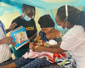 Ms. Annes Mboya and her colleagues providing breastfeeding counseling to a mother, Kakuma Refugee Camp